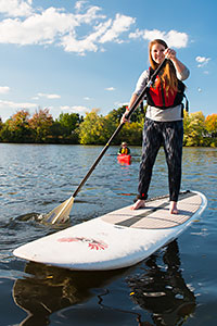 Kids love stand-up paddleboarding.