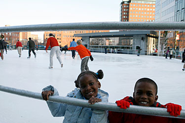 Kids rest on the railing at Community Ice Skating @Kendall.