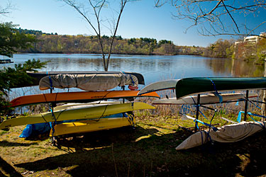 Customer canoe, kayak & SUP storage racks along the Charles River in Newton/Auburndale.