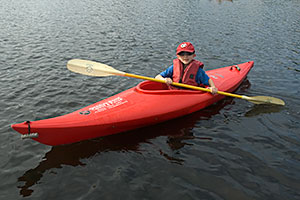 Kids love paddling their own kayak.