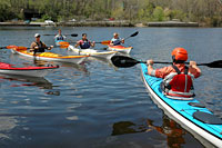 Build your skills with our classes and sea kayaking trips for people of all skill levels. Here, Danny leads a class on the Charles River.
