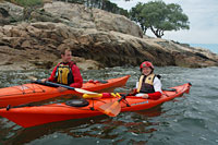Get your child on the water with our kids' kayak rentals, kids' paddling classes, and summer paddling camps! Here, Nat and a camper paddle in Cohasset Harbor.