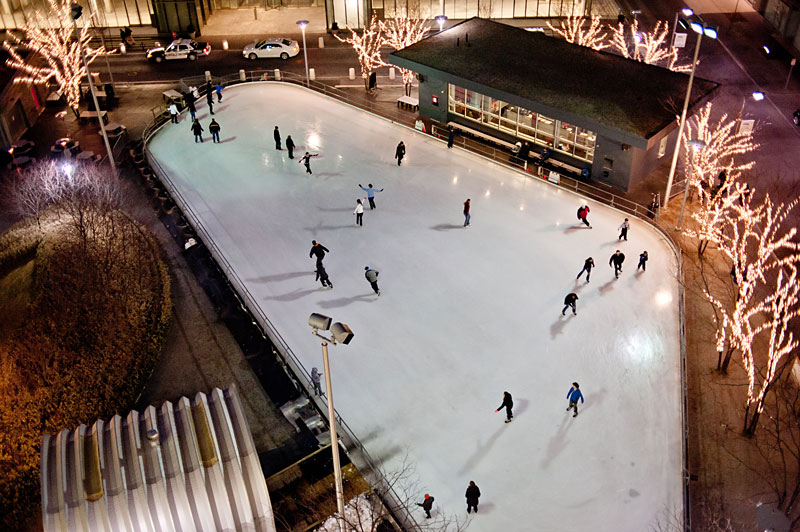 Aerial view of the skating rink at night.
