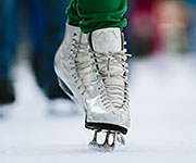 A closeup of figure skates.