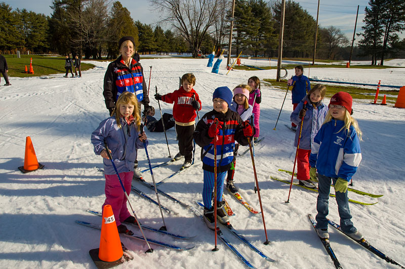 A group of child skiers.