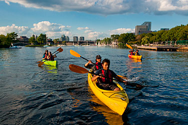 Paddlers on our Skyline Tour explore the Charles River Esplanade.