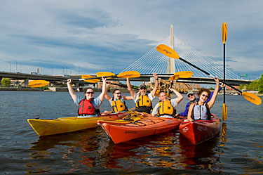 Group of Kayakers in front of Boston's Zakim Bridge.